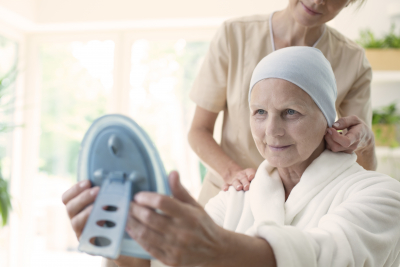 Nurse and old woman looking at the mirror